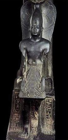 The Courtyard of the Cachette in the Temple of Amun at Karnak in Luxor (Ancient Thebes), Egypt.  Statue of Amenhotep II with Meretseger (a cobra goddess) Material: Granite Size: Height 125 cm Period: 18th Dynasty, Reign of Amenhotep II