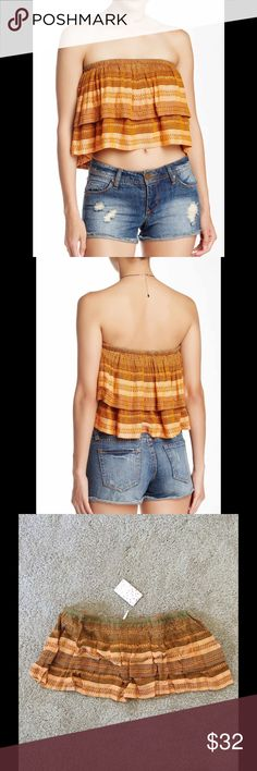 Free People Tube Top Tiered construction makes you wanna shake it up in a striped tube top. Bandeau neck, sleeveless, strapless, lined. Shell: 100% rayon. Lining: 94% cotton, 6% spandex.  Hand wash cold. Free People Tops