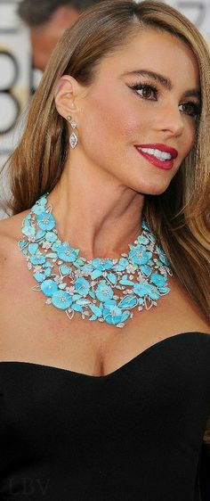 An eye catching turquoise statement necklace with a stunning cluster of many intricate  detailed turquoise flowers!