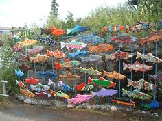 fish sculptures/ mural idea/ School of fish with Beck themewould be great art club collaborative project for a school installationCeramic or metal fish fenceschool of fish Potential idea for garden art. Attach to painted (blue) rebar?