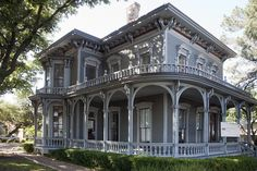 great veranda, love the colors on this victorian