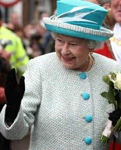 The Queen looks very fashionable in pretty turquoise....