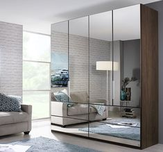 Mirrored wardrobes can be a real godsend in a small bedroom, providing vital storage and clearing away clutter, without taking up too much visual space Wardrobe Boxes, Oak Wardrobe, Wardrobe Design Bedroom, Bedroom Decor, Oak Bedroom, Mirrored Wardrobe Doors, Sliding Door Wardrobe Designs, Wardrobe With Mirror, Single Wardrobe