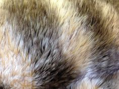 Check out this item in my Etsy shop https://www.etsy.com/listing/216716130/faux-fur-island-raccoon-beigebrown-60