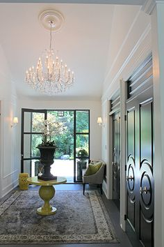 Offset by canary yellow accessories, these glazed black #FashionForward doors stun in this entryway designed by our good friend Amanda Forrest. #Hallway #Inspiration #Interior Doors
