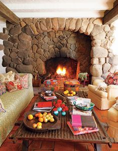 Mr trevor likes big fireplace !Old door made into coffee table, Reese Witherspoon's home in Ojai, CA. love the fireplace. but istill must have a mantel Cozy Fireplace, Fireplace Design, Fireplace Ideas, Inset Fireplace, Cottage Fireplace, Celebrity Houses, Spanish Style, Spanish Revival, Spanish Bungalow
