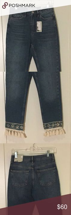 NWT Topshop Moto Straight Jeans NWT! Brand new! Topshop Moto style straight jeans with adorable blue/gold beading at the ankles with white tassles. Size 26, with a length of 30 inches to where the jeans end and the white tassles extending two more inches for a total of 32 inches. The detailing is unique and the jean material is soft. The reason I am selling is because they are too small on me.   Open to offers. Bundle to save even more! :) Topshop Jeans Straight Leg