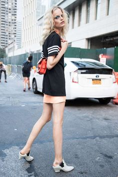 Shop this look for $189:  http://lookastic.com/women/looks/pink-mini-skirt-and-white-and-black-ankle-boots-and-red-backpack-and-black-and-white-crew-neck-t-shirt/2546  — Pink Mini Skirt  — White and Black Leather Ankle Boots  — Red Leather Backpack  — Black and White Print Crew-neck T-shirt