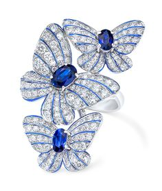 Cellini Jewelers Butterfly Ring with Sapphires and Diamonds  This gorgeous pave three butterfly ring features 1.18 carats of oval cut sapphires and 1.56 carats of round brilliant diamonds. The delicacy and vibrancy of the butterfly is further enhanced with hand painted iridescent blue enamel. Set in 18 karat white gold