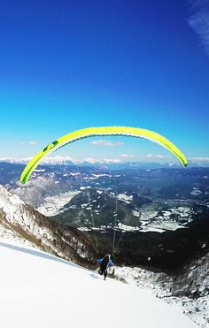 Paragliding around the Italian mountains in winter.. does this one needs any comments? Amazing!
