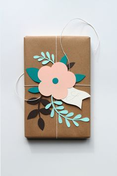 wrapping presents ... brown paper ... cardstock cut outs ... combine punches and die cuts for graphic clean look ...