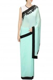 Turquoise blue sari with black and white tie-dye blouse