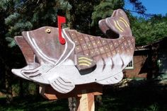 Sea Bass Novelty Mailbox by Private Label. $375.00. Construction starts with a standard U.S. Post Office approved mailbox, around which we construct a cage made out of exterior B.C. plywood. Then we cover the plywood with layers of Western Cedar. This gives the textured layered look of our Sea Bass MAILBOX. The door and back are also covered in cedar for a finished look. A wooden base plate is added to the bottom for post mounting.  After construction, our Sea ...