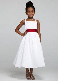 All-over satin tea-length ball gown featuring bodice with wide spaghetti straps.   Coordinating Jr. Bridesmaid Style JB2815 available.  Shown with sash Style S1041, available in 41 colors plus white and ivory.  2T-14 () and infant sizes ()are only available in White and Ivory. Available in 2T-8 in 40 colors.  Available in Ivory and White online and in stores.