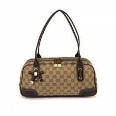 4c54fa62bb4 LXRandCo guarantees the authenticity of this vintage Gucci Princy Small  Boston Bag shoulder bag. This stylish pocketbook was crafted in gg canvas  in ...