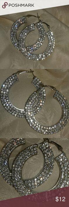 Crystal Hoop Earrings Boutique quality earrings with crystal on one side. Hang about 2 inches. Jewelry Earrings