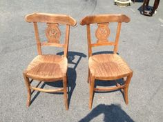 French antique pair of chairs with carved backs.