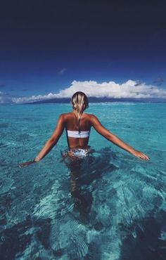 Girl walking into the blue sea. Shop the Matthew Williamson beach collection at matthewwilliamson...