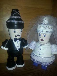 Terra cotta bride and groom by Sandy