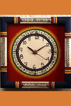 This clock is embellished with traditional Warli motifs, a tribal art from Maharashtra. It is mounted on a wooden board and painted in classic red and blue. All this makes this square shaped clock the perfect one for your drawing room.