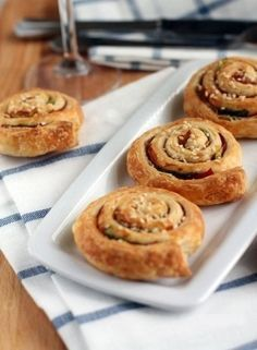 Puff pastry rolls with ham.