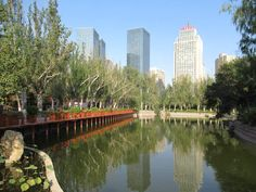 People's Park in downtown Urumqi, Xinjiang, China, is a pleasant place to relax. Urumqi, Relax, China, Park, Places, Parks, Porcelain Ceramics, Porcelain, Lugares