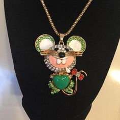 Betsey Johnson Mouse Necklace Brand new... Adorable... Betsey Johnson... Gold necklace with green jeweled mouse animated pendant...  Trade value $40 Betsey Johnson Jewelry Necklaces
