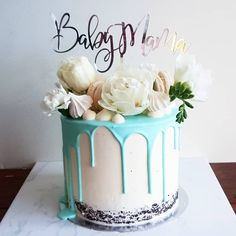 Semi naked baby shower cake with a blue drip , white flowers, meringues, macarons and topper Baby Shower Drip Cake, Fancy Baby Shower, Baby Shower Cakes For Boys, Baby Shower Cake Toppers, Blue Drip Cake, Teal Cake, Dog Cakes, Cupcake Cakes, Cupcakes