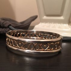 """14K Gold and Sterling Silver Millennium Bracelet If you look at it closely it says """"2000"""". This was purchased for me to mark the millennium. It is a very unique bracelet. Marked 14K / 925. Hinged and includes safety clasp. You won't find anything like it. Beautiful. I haven't worn it in 16 years. Jewelry Bracelets"""