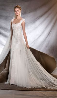Try this alluring mermaid wedding dress with square neckline and delicate straps. Tulle is used to create suggestive sheer layering over the body of the dress, giving glimpses of beautiful floral embroidery with gemstone details. From Pronovias at Schaffer's in Scottsdale, Arizona. Wedding Dress Info: PRONOVIAS – STYLE OASIS.