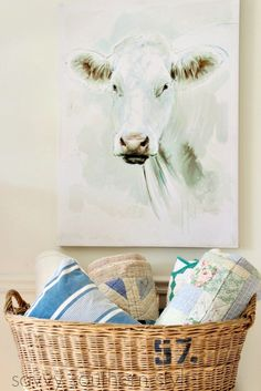 Holy Cow(s) and a Giveaway! Cow art canvas giveaway. Farmhouse style, vintage basket, vintage quilts, cow.