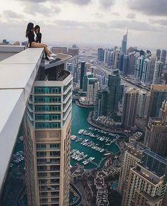 A couple of ladies enjoying the view above Dubai Marina