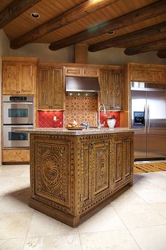 Spanish Colonial Refacing ~Artisan carved cabinetry in a Spanish Colonial Revival style. Created by Carved Custom Cabinets.