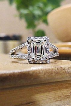 engagement rings for women halo emerald cut split