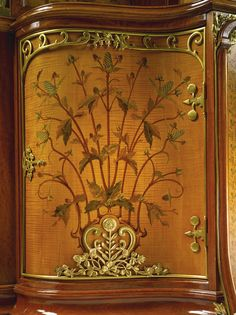 Théodore Millet A fine and important gilt bronze, satinwood, stained sycamore and fruitwood marquetry armoire Paris, circa 1900 the central cupboard door opening to three shelves, one mount removed to reveal the stamp MB from the bronze master model