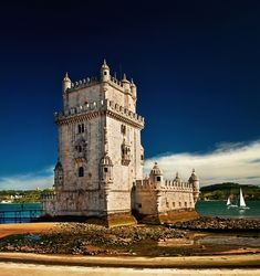 Belém Tower (in Portuguese Torre de Belém) or the Tower of St. Vincent is a fortified tower located in the civil parish of Santa Maria de Belém in the municipality of Lisbon, Portugal. It is an UNESCO World Heritage Site because of the significant role it played in the Portuguese maritime discoveries of the era of the Age of Discoveries. The tower was commissioned by King John II to be part of a defense system at the mouth of the Tagus River and a ceremonial gateway to Lisbon, Portugal