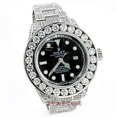 This Custom Rolex Sea Dweller DeepSea Mens Diamond Watch features 32.55 carats of genuine white diamonds, a brushed stainless steel case and a polished silver tone stainless steel diamond band. This Rolex Mens Diamond Watch showcases a black dial with luminous hour markers and a date display at the 3 oclock position. Please note: This custom Rolex diamond watch is pre-owned in excellent condition and comes with a full year warranty from ItsHot.com.