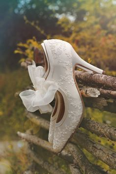 White vintage wedding shoes with hand beaded pattern detail and organza ribbon