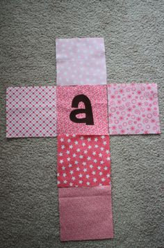 Baby Blocks Tutorial | Sew Like My Mom  (If you want to put letters or numbers on the blocks, but don't have the time to hand sew, you can also iron them on with fusible webbing or a similar method. ~ Melisa)