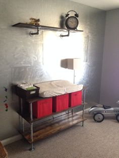 Industrial nursery with a metal wall and industrial changing table Car Nursery, Nursery Ideas, Industrial Nursery, Baby Changing Table, Kid Spaces, Baby Cribs, Metal Walls, Office Ideas, Bookshelves