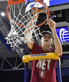 Stanford's Brittany McPhee cuts off a piece of the net after the Cardinal's upset win over Notre Dame in the Lexington regional final of the NCAA women's college basketball tournament Sunday.