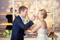 cake cutting, wedding cake, adorable couple, feeding eachother, atlanta wedding cakes, cutest couple, wedding reception, wedding photography, sweetness :: Thaddeus + Lane's Wedding at The Ambient Plus Studio in Atlanta, GA :: with Chad   Tina