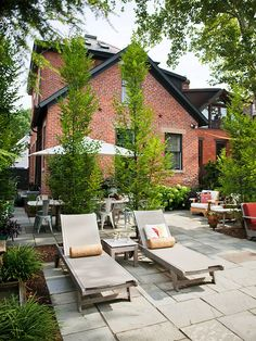 Love the stone patio with the mix of the red brick. So gorgeous.