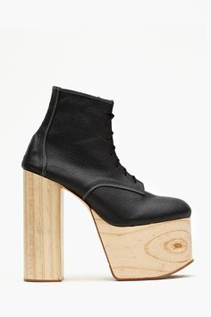 Today's So Shoe Me is the Tequila Platform Boots by Deandri, $170, available at Nasty Gal. Natural blonde wood and basic black leather combine for a cool contrasting colorway with a modern architectural shape.