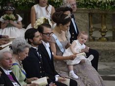 Joining the family: From right, Sweden's King Carl Gustaf, Queen Silvia, Crown Princess Victoria with her baby daughter Princess Estelle, Prince Daniel and Prince Carl Philip look on as the couple exchange vows.