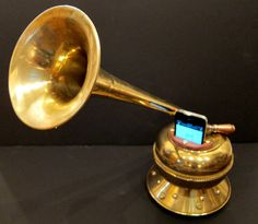 Steampunk iPhone amplifier made from a trumpet and a spitoon. Completely passive acoustics.