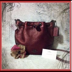 """NWT Coach Baby Mickie Drawstring Bag F35363 Coach BABY MICKIE DRAWSTRING SHOULDER BAG IN GRAIN LEATHER..New with Tags 100% Authentic Coach STYLE: F35363. Small, measuring approximately 10"""" wide from top, 8"""" wide from bottom, 8"""" long, 23-24"""" inches strap drop. Brand new, never used & great gift for yourself or a special lady, ready for a shoulder to hug. Coach Bags Crossbody Bags"""