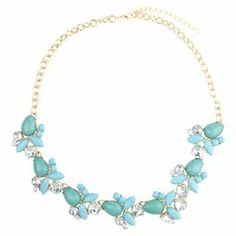"""Add a pop of style to evening ensembles and work outfits alike with this stunning gold-plated necklace, showcasing clusters of teal beads highlighted by shimmering rhinestones.     Product: NecklaceConstruction Material: Zinc alloy, resin and rhinestonesColor: Teal and goldFeatures:  Adjustable chain length adds up to 3""""Handmade   Dimensions: Chain: 19""""Stones: 1"""" H x 9.5"""" WCleaning and Care: Avoid all oils and chemicals (such as lotions, hairspray, makeup and perfumes). Put jewelry on last…"""