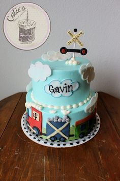 Train cake. Little boy train cake. rail road crossing signs. Two tiered birthday cake