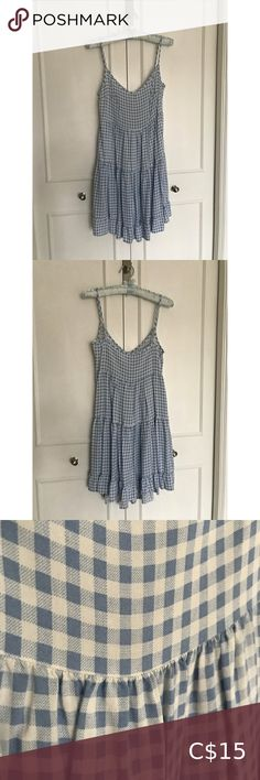 Blue Gingham Midi Dress Blue Gingham Midi Dress, falls below the knee! Only worn a couple times. Australian size 8, so a US/CAN 4.   Please message me for exact measurements before you buy if you are unsure!    Smoke-free home! Dresses Midi Blue Midi Dress, Blue Gingham, Plus Fashion, Fashion Tips, Fashion Trends, Blue And White, Smoke Free, Couple, Times